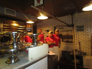 The guys in the kitchen at Lombardi's Pizza.  They made our pizza and gave me wine....I like those guys.