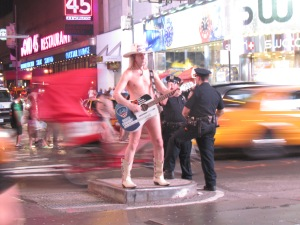The Nekked Cowboy serenading, the...police?  hahaha